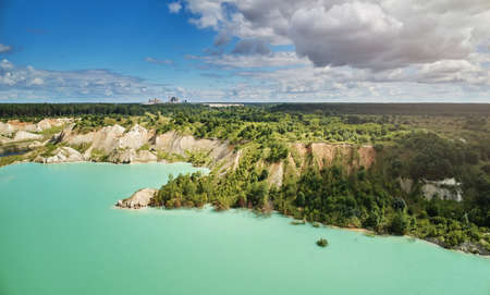 Quarry next to cement factory aerial above top view