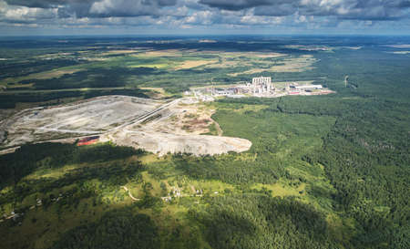 Cement factory with quarry aerial above drone view Archivio Fotografico