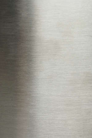 Surface of grey brushed metal background macro close up view
