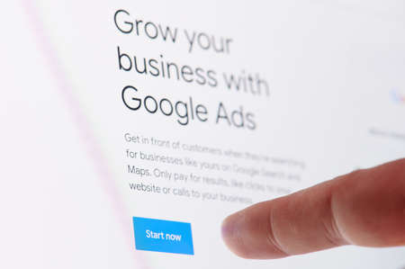 New york, USA - October 27, 2020: Start ad in google business touching screen display close up view