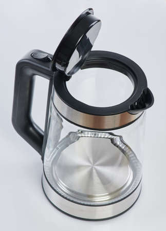 Open transparent kettle isolated on white studio background top view Archivio Fotografico