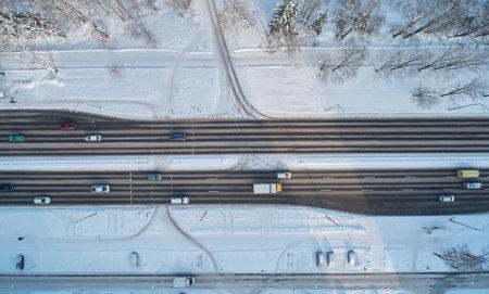 Asphalt frozen road aerial drone top view. Highway road