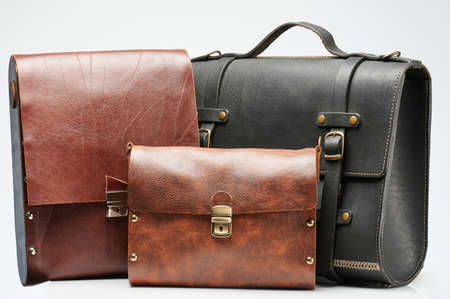 Three leather bag black and brown color isolated