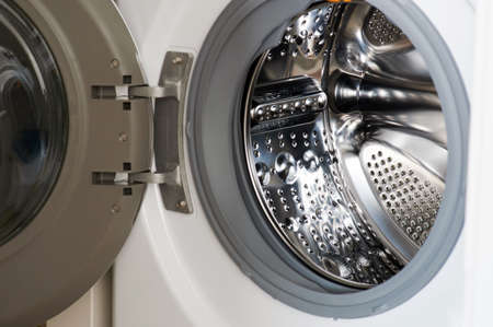 Wide open washing machine door macro close up view