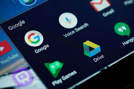New york, USA - April 26, 2021: Google search apps on device screen macro close up view Editorial
