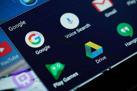 New york, USA - April 26, 2021: Google search apps on device screen macro close up view Redakční