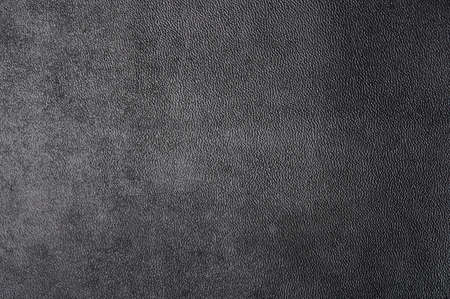 Gray leather surface background macro close up view. Pattern of cow skin