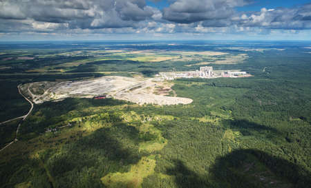 Plant mixing cement aerial view in forest background