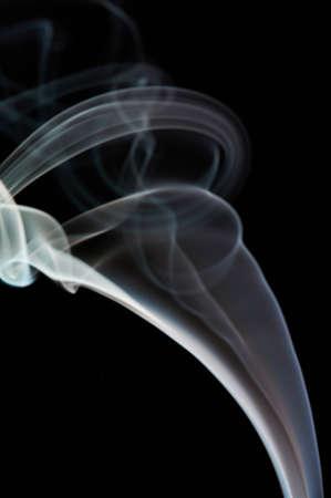 Abstract smoke swirl white color on black background. Elegant colorful curve backdrop Standard-Bild