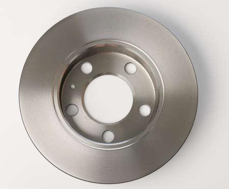 Metal shiny car brake disk system isolated on studio background Standard-Bild