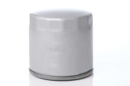 Metal grey new oil filter cylinder isolated on studio background