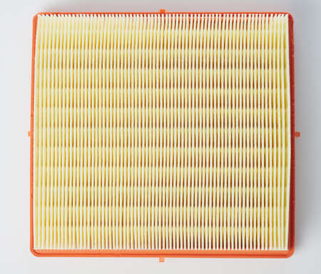 Engine car air filter square shape isolated on studio background