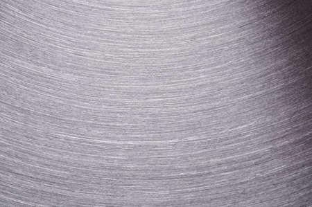 Silver iron brushed metal surface macro close up view