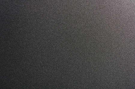 Black metal sheet background. Clean rough matte texture Standard-Bild