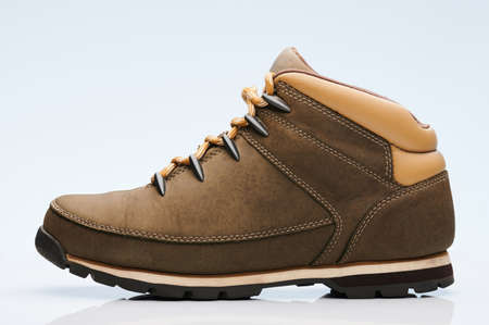 Brown hiking boot side view isolated on white background