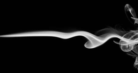 Tiny smoke line white color isolated on black background Standard-Bild