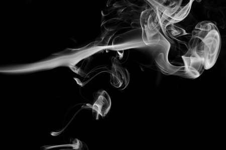 Silky smoke lines in cloud isolated on black background Standard-Bild