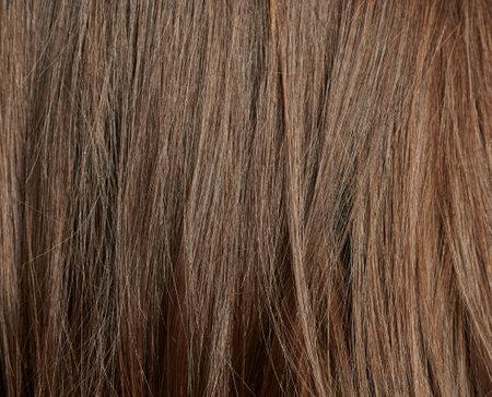 Clean dark straight hair background. Smooth hair texture Standard-Bild