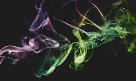 Smooth abstract smoke colorful swirls line shape on grey  backdrop Standard-Bild