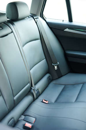 Clean comfortable leather back car seat close up view Standard-Bild
