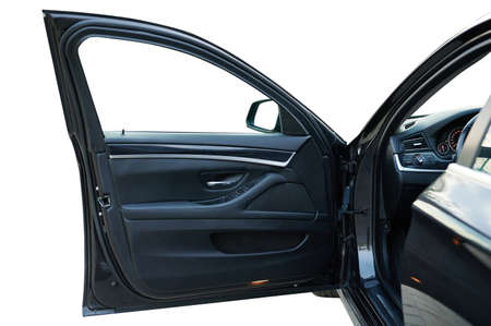 Open front car door with leather interior isolated Standard-Bild