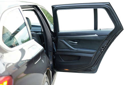 Opened sedan car rear door with leather interior isolated