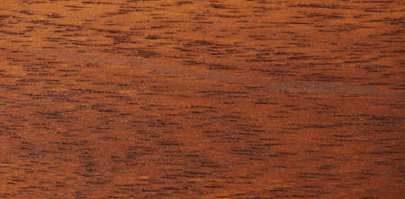 Brown wooden surface with black lines close up view