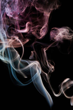 Smoke transparent color lines on black background. Abstract wallpaper