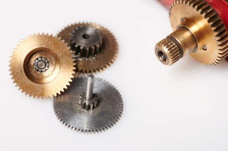 Metal. gears from servo isolated on studio background Standard-Bild