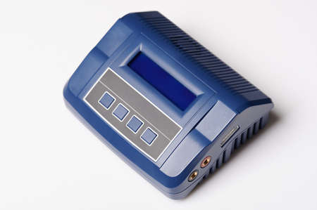 Blue professioanl charger with screen and buttons isolated on studio background