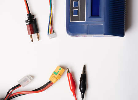 Electric cables and charger connection isolated on studio background