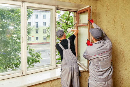 man expands window for repairs