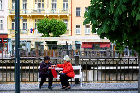 Karlovy Vary, Czech republic - April, 1, 2018: People walking along Hot springs colonnade in Karlovy Vary. Karlovy Vary historically famous for its hot springs 스톡 콘텐츠 - 113069230