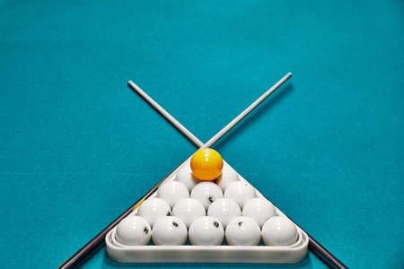 Russian billiard balls, cue, triangle, on a table. blue cloth with space for text