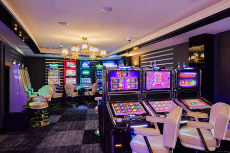 Moscow, Russia, 15.08.2019, casino, large hall with slot machines with armchairs, fortune games, prize winning