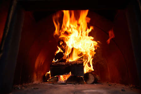 blazing flame, logs and coals, big fire Archivio Fotografico