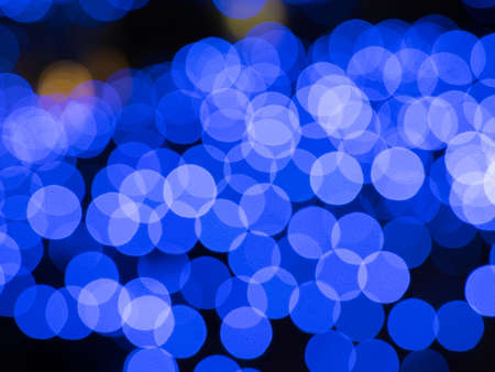 Blue bokeh background. Merry Christmas. Happy new year