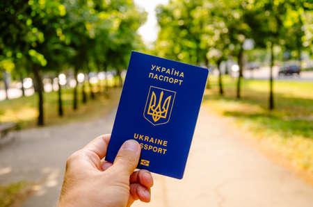 KIEV, UKRAINE - 05072019: Male hand holds Ukrainian passport Editorial