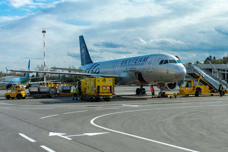 Russia, Moscow, Sheremetyevo International Airport, 05.03.2019: travel, transportation and airlines concept - a passenger plane is standing at the airport in a parking space awaiting departure, the process of preparing for the flight is in progress