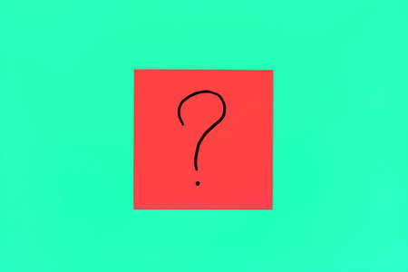 Forget, reminder, combination of colour concept- Close up black handwritten symbol of question mark on one red square sticker on mint background with copy spase, horizontal orientation 版權商用圖片