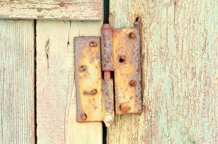 old rusty carport on a wooden door Stock Photo