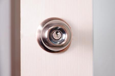 round door handle with a latch on a background of pink door