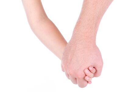 Dad holds hand of daughter on white background