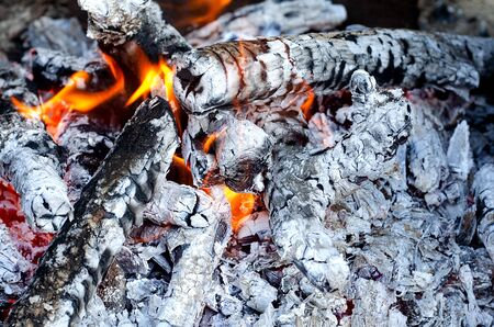 Ash and fire on wood