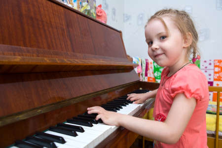 Picture of my daughter during game on the piano photo