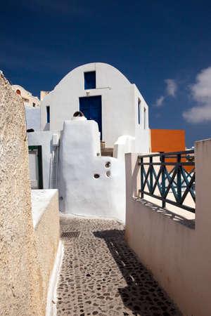 Narrow small streets of the city of Fira on island Santorini photo