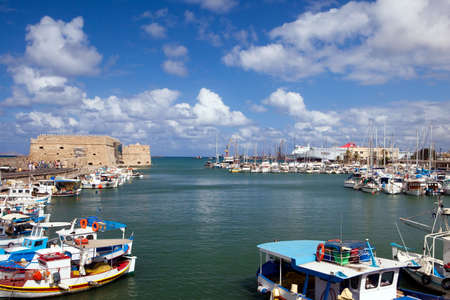horison: Port of the city of Iraklion and kind on the Venetian port with a fortress