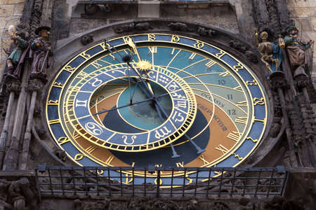 The astronomical clock situated on the wall of the old town city hall in Prague  The center section  astronomical dial  dates back to 1410, and around 1490 sculptures and the calender dial was added to it