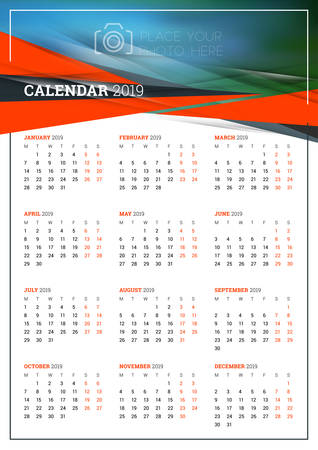 a3: Vector calendar poster A3 size for 2019 Year. Week starts on Monday. Stationery design template with abstract background and place for photo