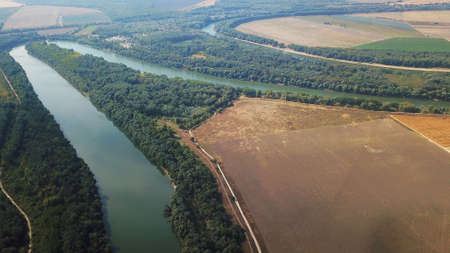 very beautiful top view of the river, field and a small forest. quadcopter photo